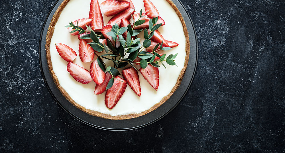 Top view of cheesecake decorated with strawberries